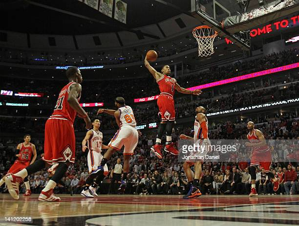Derrick Rose of the Chicago Bulls goes up for a dunk between Baron Davis and Tyson Chandler of the New York Knicks on his way to a gamehigh 32 points...