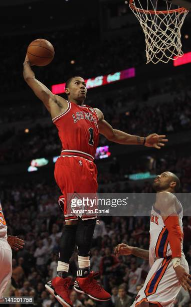 Derrick Rose of the Chicago Bulls goes up for a dunk over Tyson Chandler of the New York Knicks on his way to a gamehigh 32 points at the United...