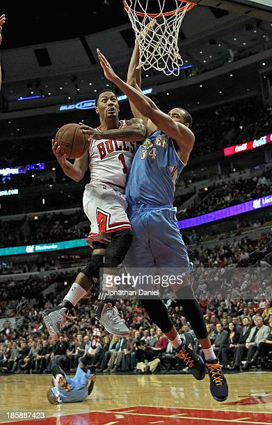 Derrick Rose of the Chicago Bulls goes up for a shot against JaVale McGee of the Denver Nuggets during a preseason game at the United Center on...