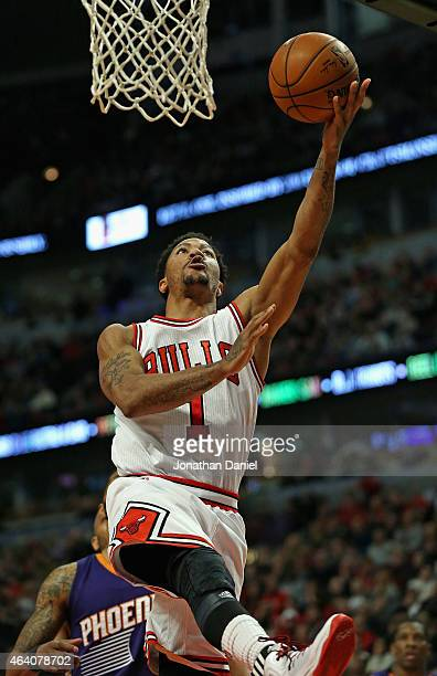 Derrick Rose of the Chicago Bulls goes up for a shot against the Phoenix Suns at the United Center on February 21 2015 in Chicago Illinois NOTE TO...