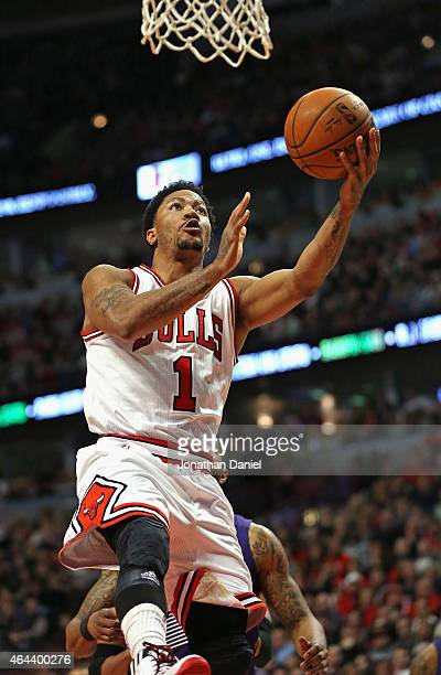 Derrick Rose of the Chicago Bulls goes up for a shot against the Phoenix Suns at the United Center on February 21 2015 in Chicago Illinois The Bulls...