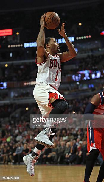 Derrick Rose of the Chicago Bulls goes up for a shot on his way to a gamehigh 23 points against the Washington Wizards at the United Center on...