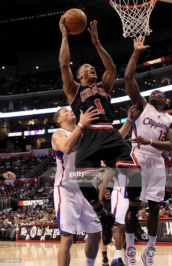 Derrick Rose #1 of the Chicago Bulls goes up for a shot over Blake Griffin #32 and Eric Bledsoe #12 of the Los Angeles Clippers at Staples Center on February 2, 2011 in Los Angeles, California.