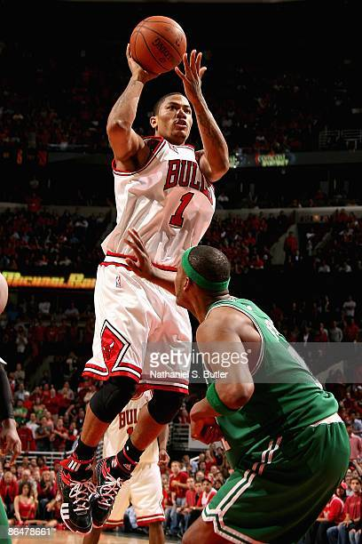 Derrick Rose of the Chicago Bulls goes up for a shot over Paul Pierce of the Boston Celtics in Game Six of the Eastern Conference Quarterfinals...