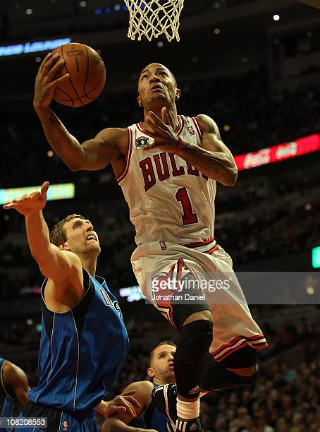 Derrick Rose of the Chicago Bulls goes up for a shot past Dirk Nowitzki of the Dallas Mavericks on his way to a gamehigh 26 points at the United...