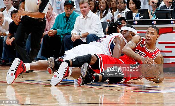 Derrick Rose of the Chicago Bulls grabs a loose ball against Joe Johnson of the Atlanta Hawks in Game Four of the Eastern Conference Semifinals in...