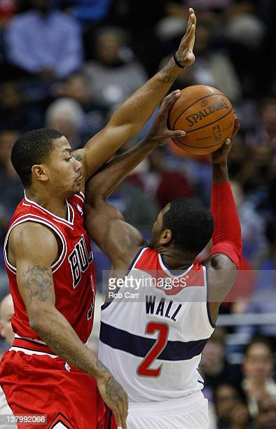 Derrick Rose of the Chicago Bulls guards John Wall of the Washington Wizards during the first half at Verizon Center on January 30 2012 in Washington...
