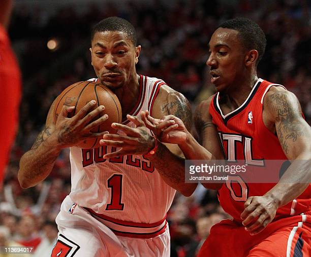 Derrick Rose of the Chicago Bulls hangs on to the ball as he moves past Jeff Teague of the Atlanta Hawks in Game Two of the Eastern Conference...