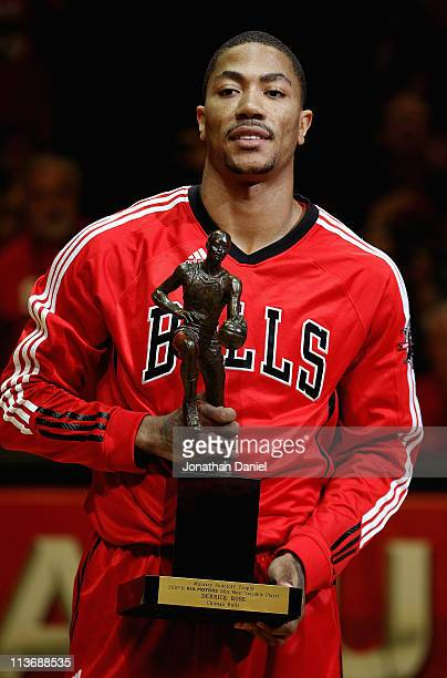 Derrick Rose of the Chicago Bulls holds the Maurice Podoloff Trophy awarded to the NBA Most Valuable Player before taking on the Atlanta Hawks in...