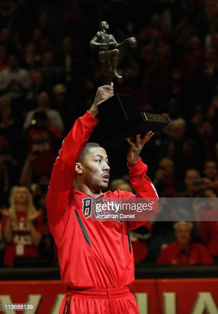 Derrick Rose of the Chicago Bulls holds up the Maurice Podoloff Trophy awarded to the NBA Most Valuable Player before taking on the Atlanta Hawks in...