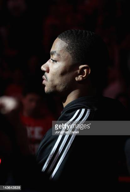Derrick Rose of the Chicago Bulls injured in game one against the Philadelphia 76ers stands in front of the Bulls bench during player introductions...