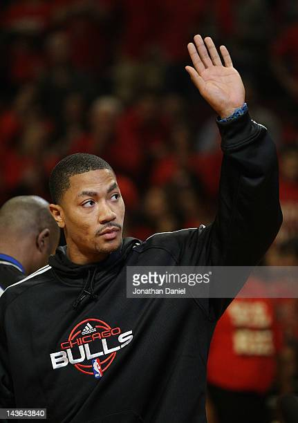 Derrick Rose of the Chicago Bulls injured in game one against the Philadelphia 76ers waves to the crowd before Game Two of the Eastern Conference...