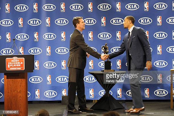 Derrick Rose of the Chicago Bulls is congratulated by Tim Chaney of Kia Motors after receiving the 201011 Kia NBA Most Valuable Player Award on May 3...