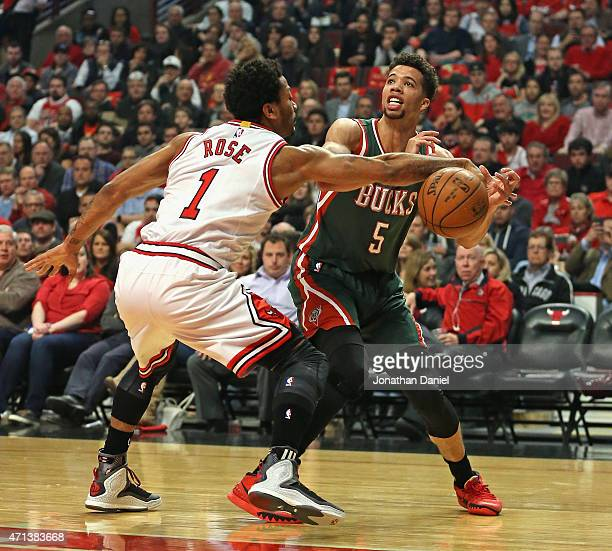 Derrick Rose of the Chicago Bulls knocks the ball away from Michael CarterWilliams of the Milwaukee Bucks during the first round of the 2015 NBA...