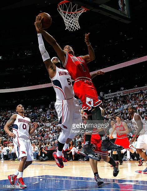 Derrick Rose of the Chicago Bulls lays drives to the basket against Josh Smith of the Atlanta Hawks in Game Three of the Eastern Conference...