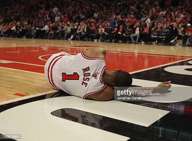 Derrick Rose of the Chicago Bulls lays on the floor aftrer suffering an injury against the Philadelphia 76ers in Game One of the Eastern Conference...