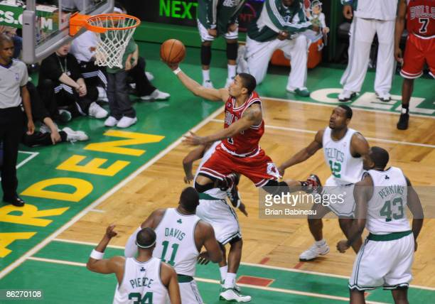 Derrick Rose of the Chicago Bulls lays the ball in the basket against the Boston Celtics in Game Five of the Eastern Conference Quarterfinals during...