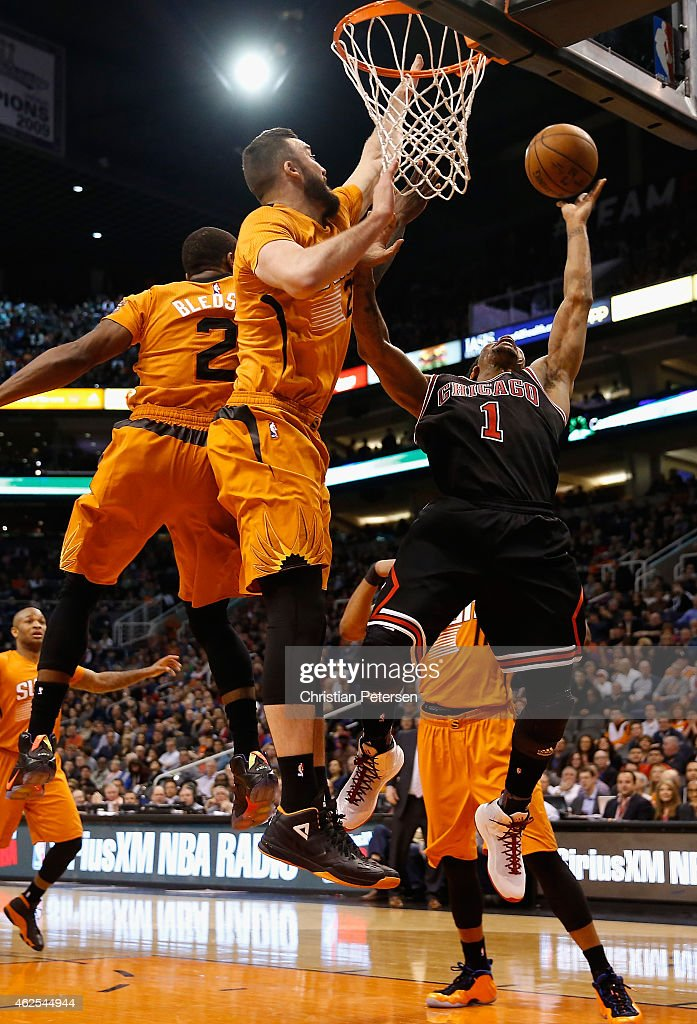 Derrick Rose #1 of the Chicago Bulls lays up a shot past Miles Plumlee #22 of the Phoenix Suns during the first half of the NBA game at US Airways Center on January 30, 2015 in Phoenix, Arizona.