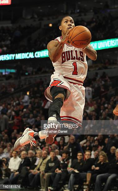 Derrick Rose of the Chicago Bulls leaps through the air to the basket against the New Orleans Hornets at the United Center on February 28 2012 in...