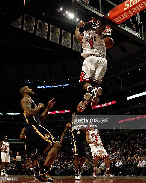 Derrick Rose of the Chicago Bulls leaps to dunk the ball against the Indiana Pacers at the United Center on February 24 2010 in Chicago Illinois The...