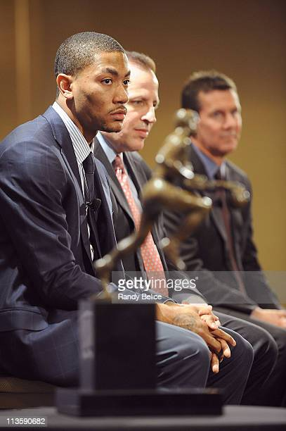 Derrick Rose of the Chicago Bulls listens to remarks along with Bulls Head Coach Tom Thibodeau and Tim Chaney of Kia Motors during the 201011 Kia NBA...