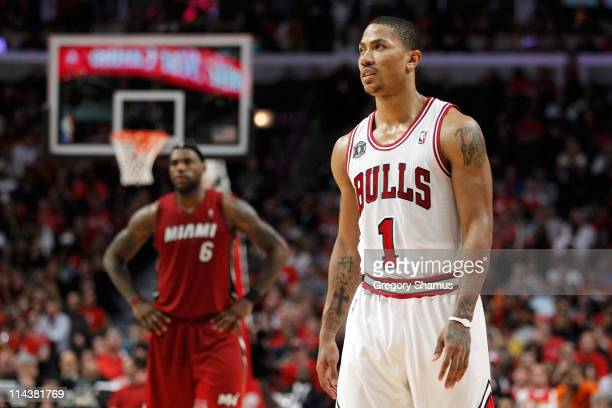 Derrick Rose of the Chicago Bulls looks on as LeBron James of the Miami Heat stands in the background in Game Two of the Eastern Conference Finals...