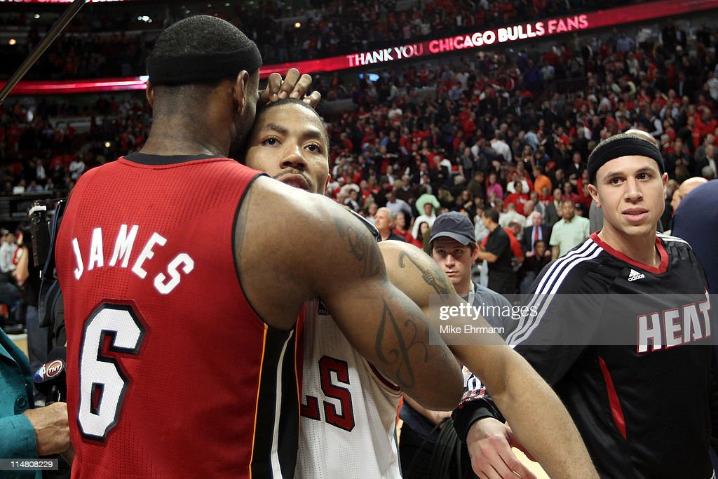 Derrick Rose #1 of the Chicago Bulls looks on dejected as he congratulates LeBron James #6 of the Miami Heat after the Heat won 83-80 in Game Five of the Eastern Conference Finals during the 2011 NBA Playoffs on May 26, 2011 at the United Center in Chicago, Illinois.