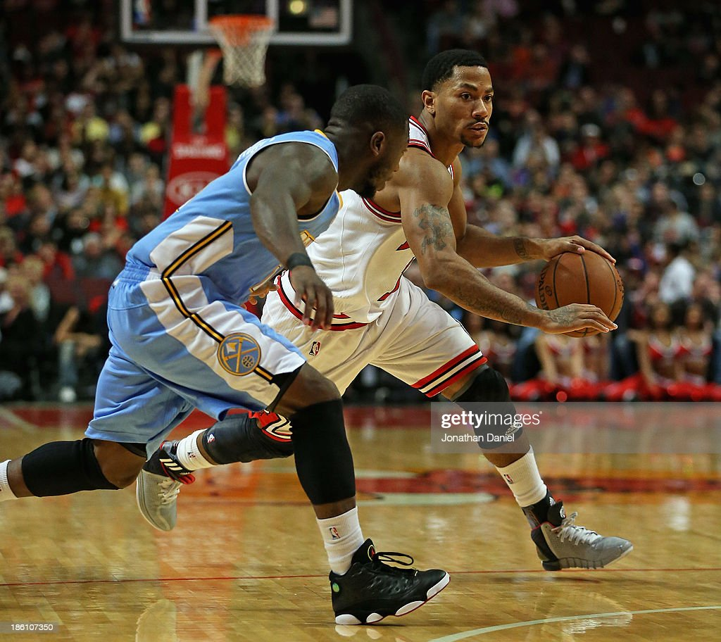 64b9471db31 Derrick Rose of the Chicago Bulls moves against Nate Robinson of the ...