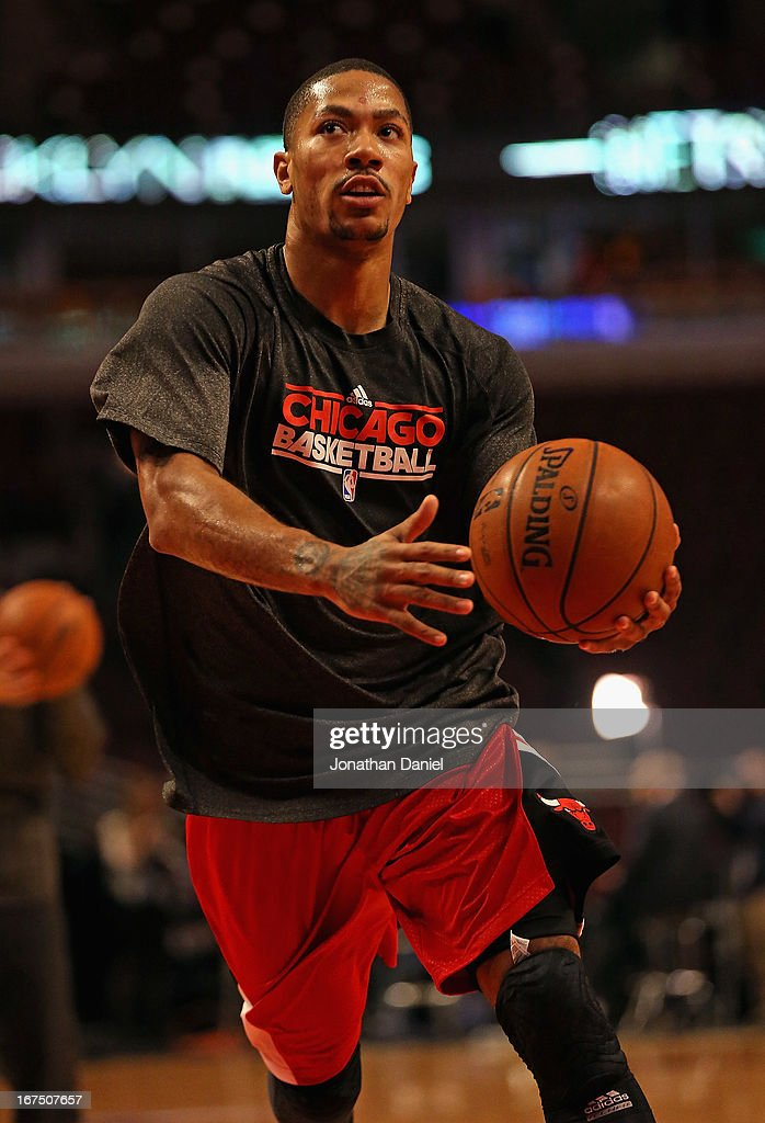 9ceabe346245 Derrick Rose of the Chicago Bulls participates in warm-ups before ...