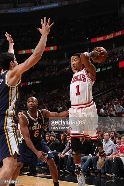 Derrick Rose of the Chicago Bulls passes the ball against Jamaal Tinsley of the Utah Jazz on November 8 2013 at the United Center in Chicago Illinois...