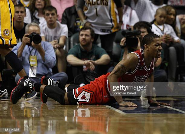 Derrick Rose of the Chicago Bulls picks himself up off of the floor after being knocked down against the Indiana Pacers in Game Four of the Eastern...