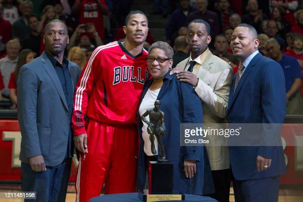Derrick Rose of the Chicago Bulls poses for a photo with his family and the KIA Motors NBA MVP Trophy prior to Game Two of the Eastern Conference...
