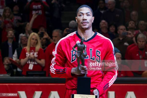 Derrick Rose of the Chicago Bulls poses for a photo with the KIA Motors NBA MVP Trophy prior to Game Two of the Eastern Conference Semifinals between...