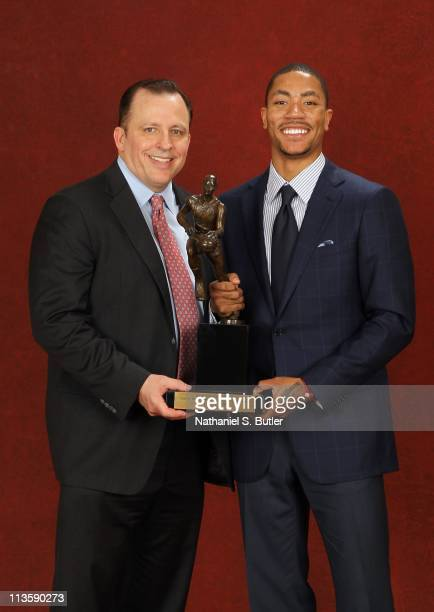 Derrick Rose of the Chicago Bulls poses with Head Coach Tom Thibodeau and the 201011 Kia NBA Most Valuable Player Award on May 3 2011 in Lincolnshire...