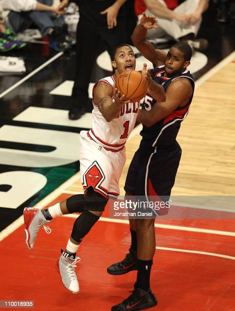 Derrick Rose of the Chicago Bulls puts up a shot against Al Horford of the Atlanta Hawks on his way to a gamehigh 34 points at the United Center on...