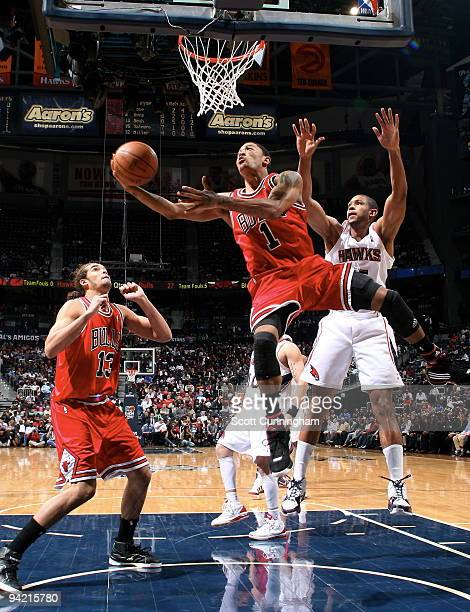Derrick Rose of the Chicago Bulls puts up a shot against Al Horford of the Atlanta Hawks on December 9 2009 at Philips Arena in Atlanta Georgia NOTE...