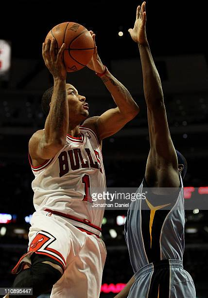 Derrick Rose of the Chicago Bulls puts up a shot against Zach Randolph of the Memphis Girzzlies on his way to a gamehigh 24 points at the United...