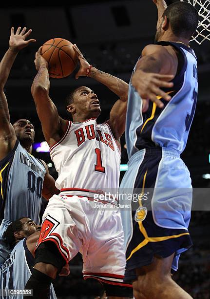 Derrick Rose of the Chicago Bulls puts up a shot between Darrell Arthur and Shane Battier of the Memphis Girzzlies on his way to a gamehigh 24 points...