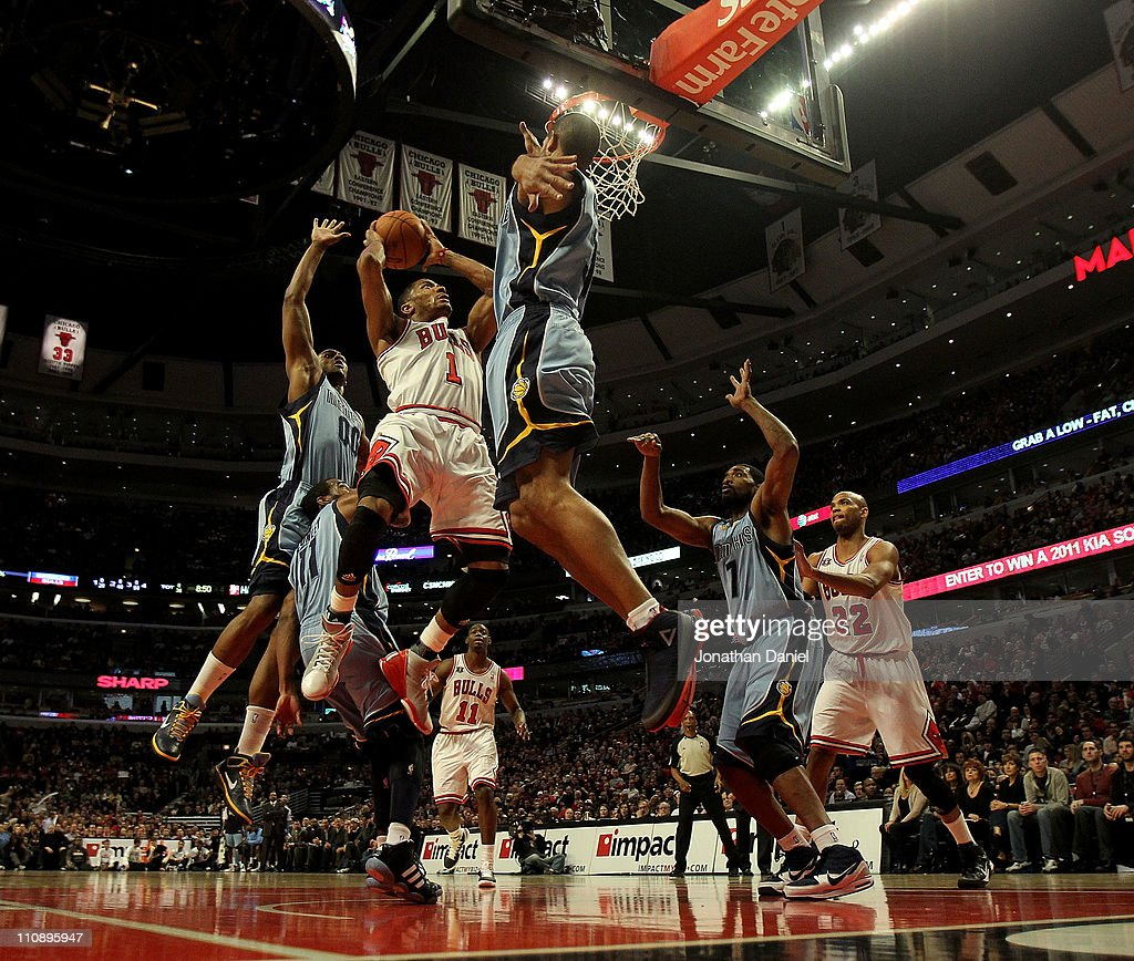 Derrick Rose #1 of the Chicago Bulls puts up a shot between Darrell Arthur #00, Mike Conley #11 and Shane Battier #31 of the Memphis Girzzlies on his way to a game-high 24 points at the United Center on March 25, 2011 in Chicago, Illinois. Rose will donate $1,000.00 for every point he scored tonight to the Direct Relief Japan Relief and Recovery Fund. The Bulls defeated the Grizzlies 99-96.