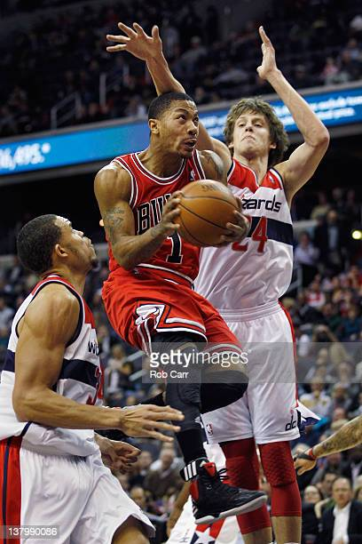 Derrick Rose of the Chicago Bulls puts up a shot in front of JaVale McGee and Jan Vesely of the Washington Wizards during the first half at Verizon...