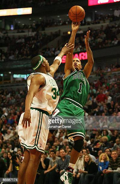Derrick Rose of the Chicago Bulls puts up a shot over Paul Pierce of the Boston Celtics on March 17 2009 at the United Center in Chicago Illinois The...