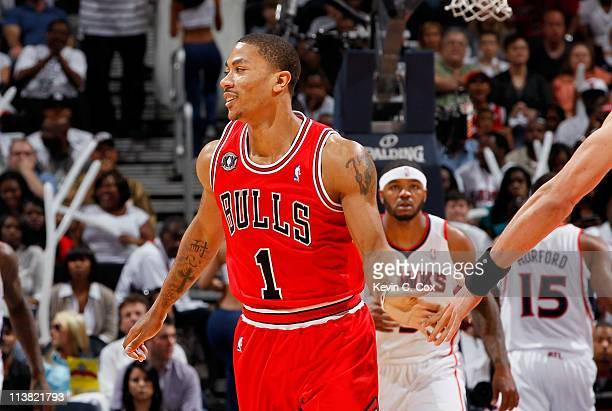 Derrick Rose of the Chicago Bulls reacts after hitting a three-point basket against the Atlanta Hawks in Game Three of the Eastern Conference...