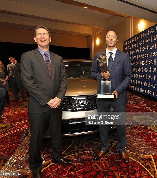 Derrick Rose of the Chicago Bulls receives the 201011 Kia NBA Most Valuable Player Award from Kia's Tim Chaney on May 3 2011 in Lincolnshire Illinois...