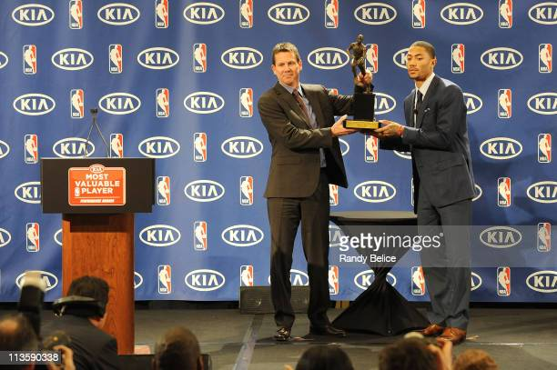 Derrick Rose of the Chicago Bulls receives the 201011 Kia NBA Most Valuable Player Award from Tim Chaney of Kia Motors on May 3 2011 in Lincolnshire...