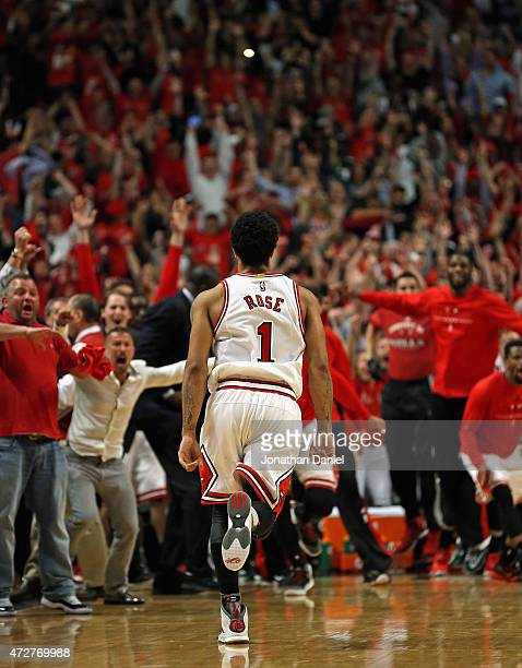 Derrick Rose of the Chicago Bulls runs toward the Bulls bench after hitting the game-winning shot against the Cleveland Cavaliers in Game Three of...