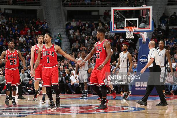 Derrick Rose of the Chicago Bulls shakes hands with Jimmy Butler of the Chicago Bulls during the game against the Detroit Pistons on January 18 2016...