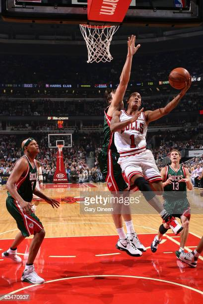 Derrick Rose of the Chicago Bulls shoots a layup against Andew Bogut of the Milwaukee Bucks on October 28 2008 at the United Center in Chicago...