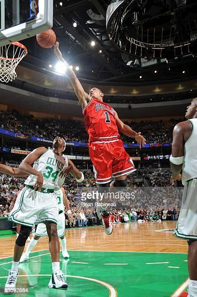 Derrick Rose of the Chicago Bulls shoots a layup against Paul Pierce of the Boston Celtics during the game at the TD Banknorth Garden on October 31...