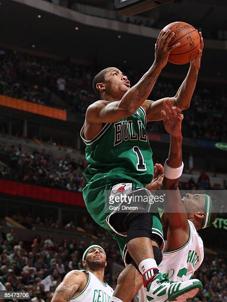 Derrick Rose of the Chicago Bulls shoots a layup against Paul Pierce of the Boston Celtics on March 17 2009 at the United Center in Chicago Illinois...