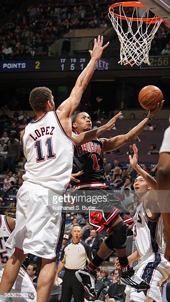 Derrick Rose of the Chicago Bulls shoots against Brook Lopez of the New Jersey Nets on April 9 2010 at the IZOD Center in East Rutherford New Jersey...